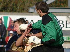 David Town gets a fistful in the collision that injured Ormerod (Dave Haines)